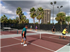 Three Men Playing Pickleball