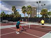 Men and Women playing Pickleball