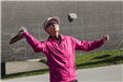 Woman in Pick Jacket Hitting Pickleball