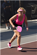 Woman in Pink Outfit Playing Pickleball