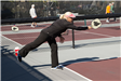 Woman in Black Outfit Playing Pickleball