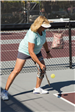 Woman About to Hit a Pickleball