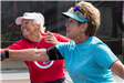 Two Women Trying to Hit a Ball