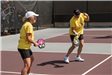 Two Women in Yellow T-Shirts Playing Playing Pickleball