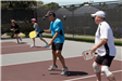 Two Men Two Women on the Pickleball Court
