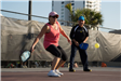 Woman Getting Ready to Hit Pickleball