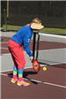 Woman in Colorful Outfit Hitting the Ball