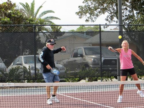 Man and Woman playing pickleball