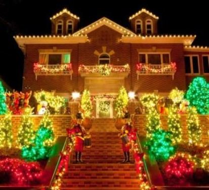 House with Christmas Lights Lit Up at Night